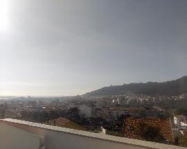Estudio com solario e vista para a cidade