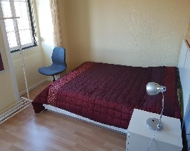 Shared room with master bed for couple in Penha de Franca